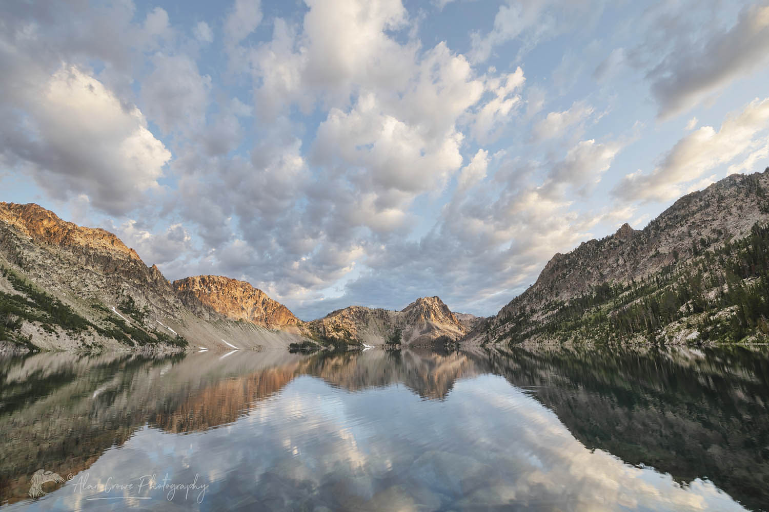 Morning clouds mirrored in still waters of Sawtooth Lake. Sawtooth Mountains Wilderness Idaho New Additions Sawtooth Mountains